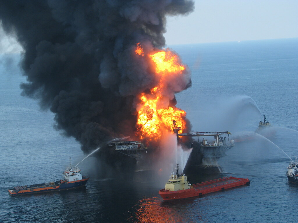 Boats spray water on the Deepwater Horizon drilling platform fire.